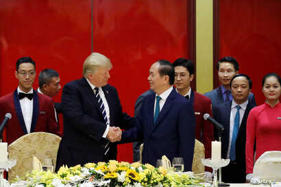 Vietnam's President Tran Dai Quang welcomes U.S. President Donald Trump with a state banquet at the International Convention Center in Hanoi, Vietnam, Nov. 11, 2017.