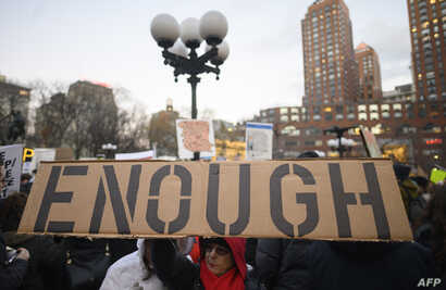 Demonstrators participate in a President's Day protest against US President Donald Trump immigration policy at the Union Square on February 18, 2019 in New York City.