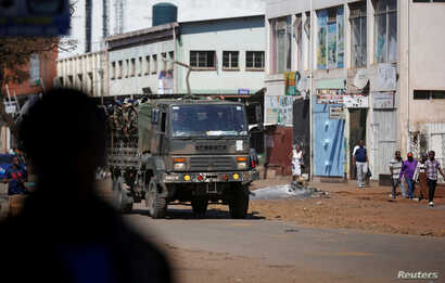 Members of the military patrol the streets of the capital Harare, Aug. 2, 2018.