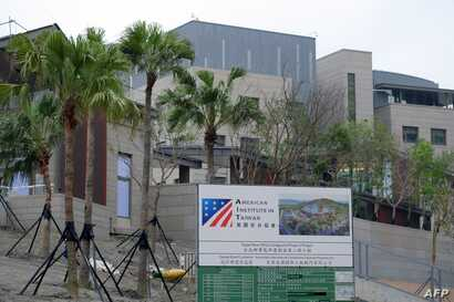 In this photograph taken on May 3, 2018, construction signage is seen in front of the newly-built American Institute in Taipei (AIT) building in Taipei.