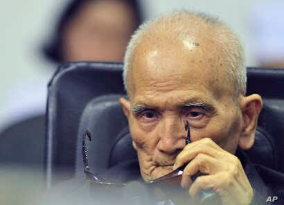 In this photo released by the Extraordinary Chambers in the Courts of Cambodia, Nuon Chea, who was the Khmer Rouge's chief ideologist and No. 2 leader, sits in a courtroom before a hearing at the U.N.-backed war crimes tribunal in Phnom Penh, Cambodi...