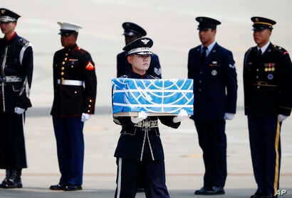 A soldier carries a casket containing a remain of a U.S. soldier who was killed in the Korean War during a ceremony at Osan Air Base in Pyeongtaek, South Korea, July 27, 2018.