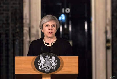 Britain's Prime Minister Theresa May gives a media statement outside 10 Downing street in London, March 22, 2017, following a terror attack in the Westminster area of London earlier Wednesday.