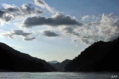 FILE - The sun sets over the Mekong river Oct., 16, 2009, near Pak Beng in northern Laos near the Thai border.