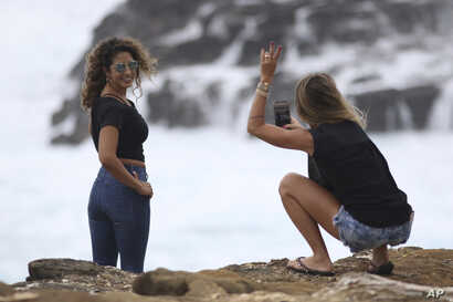 Arad Blum, right, who lives in Honolulu but is originally from Israel, and Reut Laxer, who is visiting Blum from Israel, take photos along the southeast shore of Oahu as Hurricane Lane approaches,  Aug. 24, 2018