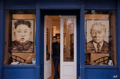 Artworks featuring U.S. President Donald Trump and North Korean leader Kim Jong Un are displayed at a gallery, Feb. 28, 2019, in Hanoi, Vietnam.