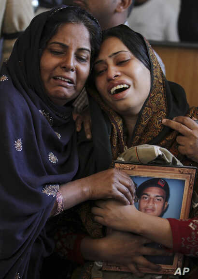 FILE - Pakistani women mourn the death of a family member during a funeral in Karachi, Pakistan, Jan. 18, 2013. The shooting death of  Shahzeb Khan, 20, in one of Karachi's most upscale neighborhoods highlighted a growing trend of citizens using soci...