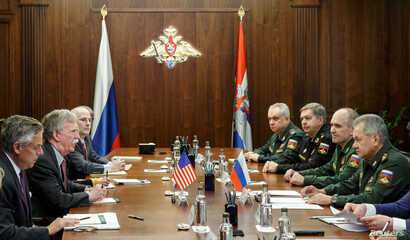 Delegations, led by Russia's Defencs Minister Sergei Shoigu (R) and U.S. National Security Adviser John Bolton (2nd L), meet in Moscow, Russia, Oct. 23, 2018.