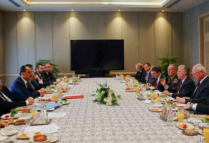 White House National Security Adviser John Bolton, 2nd right, and senior adviser to Turkish President Recep Tayyip Erdogan, Ibrahim Kalin, left, head their delegations during a meeting at the Presidential Palace in Ankara, Turkey, Jan. 8, 2019.