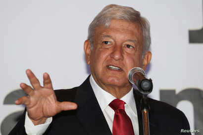 Andres Manuel Lopez Obrador, of the National Regeneration Movement, speaks at an event to present new members of his campaign staff, in Monterrey, Mexico, Jan. 15, 2018. The leftist opposition candidate has enjoyed a double-digit poll lead over his r...
