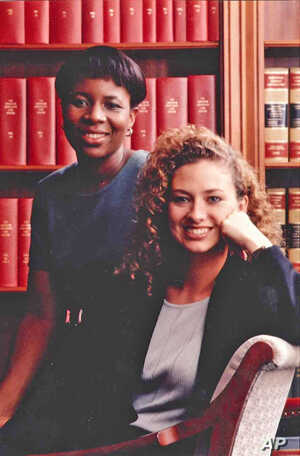 Layli Miller-Muro(seated) successfully litigated on behalf of Fauziya Kassindja, who would have faced female genital mutilation before she was granted asylum in the US.