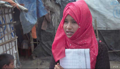 Sameela Kotima, an outpatient therapeutic volunteer, goes into the Rohingya refugees camps in Cox's Bazaar, Bangladesh, to follow up with new parents and to counsel young women about sexual health.