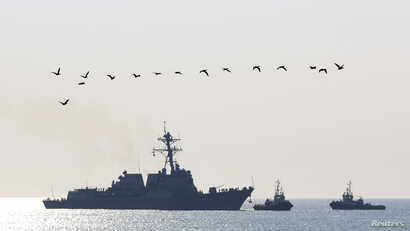 FILE - The USS Truxtun, a U.S. guided-missile destroyer, enters the Black Sea port of Varna, Bulgaria, March 13, 2014.