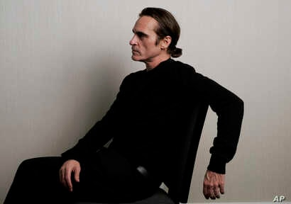 """In this Sept. 8, 2018 photo Joaquin Phoenix, a cast member in the film """"The Sisters Brothers,"""" poses for a portrait at the Adelaide Hotel during the Toronto International Film Festival in Toronto."""