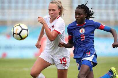 Midfielder Sherly Jeudi, right, in action during the U-20 championship match against Canada. (FHF photo)