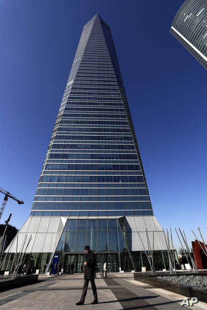 This Jan. 16, 2019 photo shows the Crystal Tower skyscraper in Madrid, Spain. The high-rise building supposedly hosted a company called FlameTech.