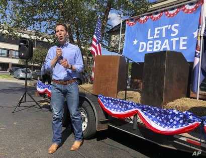 In this Sept. 12, 2018, photo, Missouri GOP Attorney General Josh Hawley speaks to voters during a stop in Columbia, Mo. Hawley is trying to unseat Democratic Sen. Claire McCaskill.