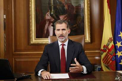 In this image released by the Spanish Royal Palace, Spain's King Felipe VI delivers a speech on television from Zarzuela Palace in Madrid, Oct. 3, 2017.
