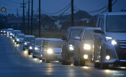 A traffic jam is seen as people evacuate after tsunami advisories were issued following an earthquake, in Iwaki, Fukushima prefecture, Japan, in this photo taken by Kyodo, Nov. 22, 2016.