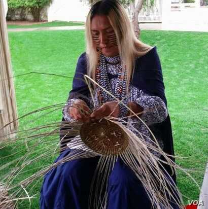 "Shown is Timothy ""Twix"" Ward, San Carlos Apache two spirit, who specializes in the traditional craft of basket weaving.  Courtesy:  powwows.com"