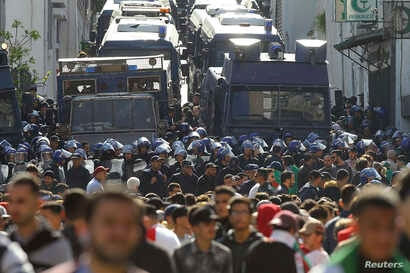 Protesters and riot police face off during a protest in Algiers, Algeria, March 29, 2019.