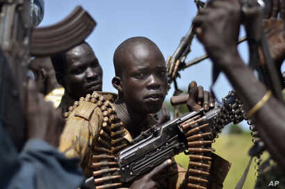 FILE - South Sudan government soldiers in the town of Koch, Unity state, South Sudan.
