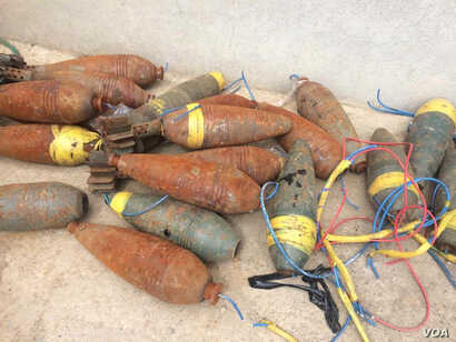 Iraqi forces find bombs, IEDs and other explosive devises as IS is defeated, April 2017. (H. Murdock/VOA)