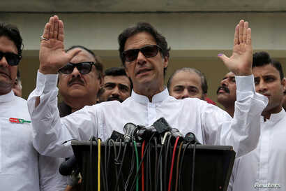 Cricket star-turned-politician Imran Khan, chairman of Pakistan Tehreek-e-Insaf (PTI), speaks to members of media after casting his vote at a polling station during the general election in Islamabad, Pakistan, July 25, 2018.