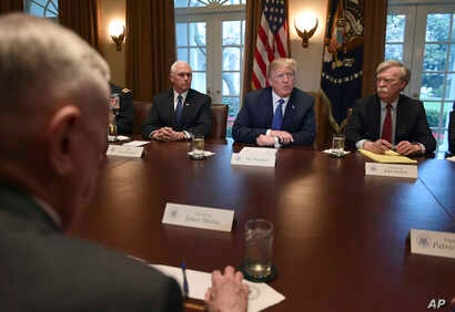 U.S. President Donald Trump, second from right, speaks in the Cabinet Room of the White House in Washington, April 9, 2018, at the start of a meeting with military and national security leaders.