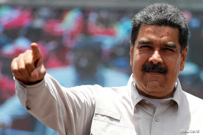 Venezuela's President Nicolas Maduro greets supporters during a campaign rally in Charallave, Venezuela, May 15, 2018.