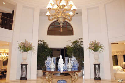 FILE - Photo provided by U.S. Immigration and Customs Enforcement (ICE) shows the interior of the Malibu, California, mansion of the son of Equitorial Guinea's president, Teodoro Nguema Obiang Mangue, during the execution of a search warrant.