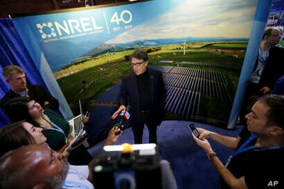 U.S. Secretary of Energy Rick Perry speaks to reporters at an Earth Day display at Fair Park in Dallas, April 21, 2017.