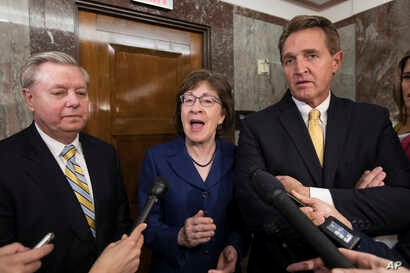 Sen. Lindsey Graham, R-S.C., from left, Sen. Susan Collins, R-Maine, and Sen. Jeff Flake, R-Ariz., speak to reporters after working with a bipartisan group of moderate senators to find a way to reopen the government, at the Capitol in Washington, Jan...
