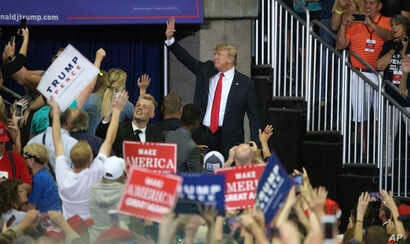 President Donald Trump waves as he leaves a campaign rally, June 20, 2018, in Duluth, Minn.
