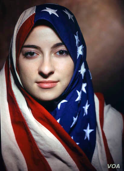 "Boushra Almutawakel, Untitled, from the series ""The Hijab,"" 2001; Chromogenic print, 47 1/4 x 39 3/8 in. (Courtesy of the artist and the Howard Greenberg Gallery)"