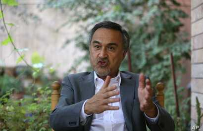 Mohammad Daud Sultanzoy, a former lawmaker overseeing the handover of military airports for the Afghan government, speaks during an interview with the Associated Press in Kabul, Afghanistan, Aug 18, 2015.