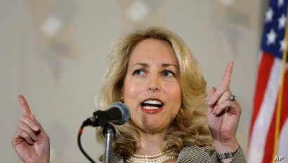 """FILE -  Former CIA officer Valerie Plame Wilson speaks at an annual """"power lunch"""" in Chicago."""