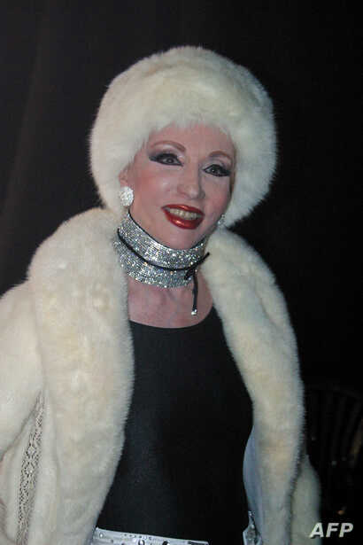 FILE - An undated file picture from the 1990s shows late Lebanese singer Sabah arriving at an official function in a desingner winter outfit in Beirut.