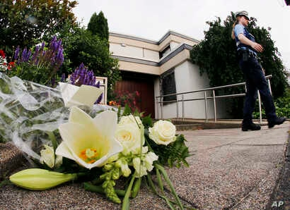 Flowers sit in front of the house of former German Chancellor Helmut Kohl in Oggersheim, Germany, June 16, 2017.