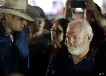 Stephen Willeford, right, and Johnnie Langendorff, left, attend a vigil for the victims of the First Baptist Church shooting in Sutherland Springs, Texas, Nov. 6, 2017. Willeford shot suspect Devin Patrick Kelley, and Langendorff drove the truck whil...