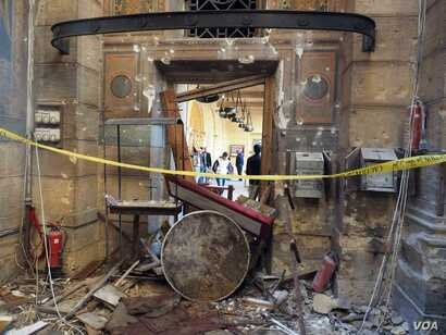 """Leftovers from the explosion inside the """"Botrosia"""" church in Abbassya, the blast affected the church building's structure, in Cairo, Egypt, Dec.11, 2016."""