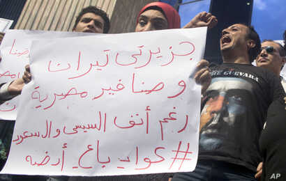 Activists shout slogans against Egyptian President Abdel-Fattah el-Sissi during a protest against the decision to hand over control of two strategic Red Sea islands to Saudi Arabia outside the Press Syndicate building, in Cairo, Egypt, Wednesday, Apr...