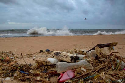 FILE - A plastic bottle lies among other debris washed ashore on an Indian Ocean beach in Uswetakeiyawa, north of Colombo, Sri Lanka, Aug. 13, 2015.
