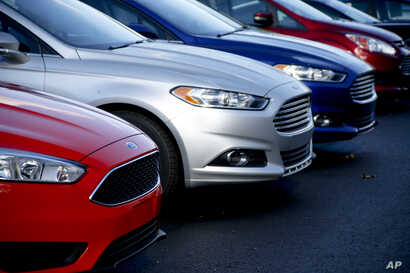FILE - Ford Fusions are for sale on the lot at Butler County Ford in Butler, Pa., in November 2015. Ford Motor Co. has built the midsize Fusion sedan at its plant in Hermosillo, Mexico, since its introduction in 2005.