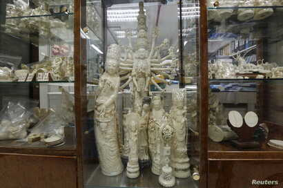 Products from elephant ivory are displayed on the centre column of a shelf inside a carving and jewellery factory in Hong Kong, Oct. 23, 2015.