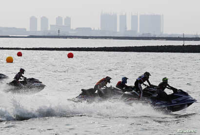 The jetski competition of the 2018 Asian Games, with a hazy Jakarta, Indonesia, in the background, Aug. 24, 2018