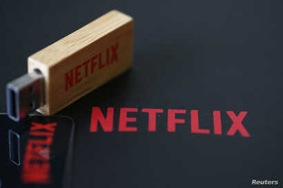 FILE - USB key with the logo of Netflix, the American provider of on-demand Internet streaming media, is seen in this illustration photo, in Paris, France, Sept. 15, 2014.