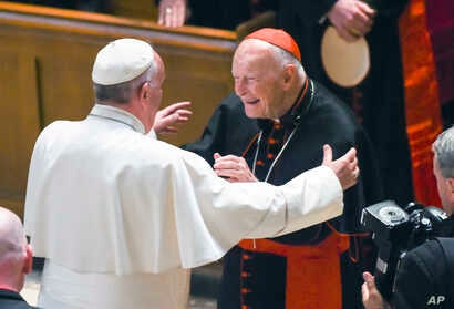 FILE - In this Sept. 23, 2015 file photo, Pope Francis reaches out to hug Cardinal Archbishop emeritus Theodore McCarrick after the Midday Prayer of the Divine with more than 300 U.S. Bishops at the Cathedral of St. Matthew the Apostle in Washington....
