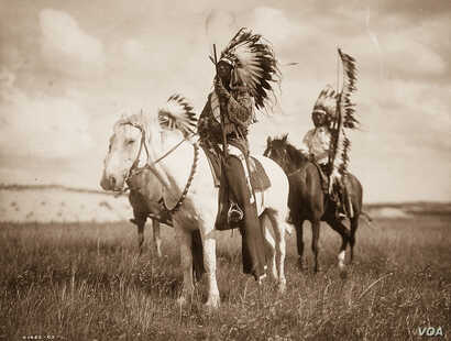 Photograph shows three Native Americans on horseback, 1905.  Horses transformed tribal cultures and forever changed the way they hunted and fought in battle.  Photograph by Edward S. Curtis, Curtis (Edward S.) Collection, Library of Congress Prints a...