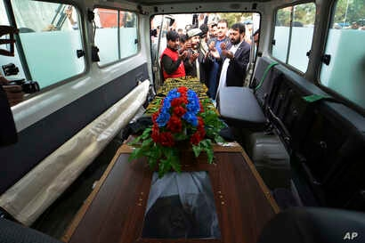 Nangarhar officials hand over the body of Tahir Dawar, a Pakistani police officer, to Pakistani tribal elders in  Jalalabad, east of Kabul, Afghanistan, Nov. 15, 2018.